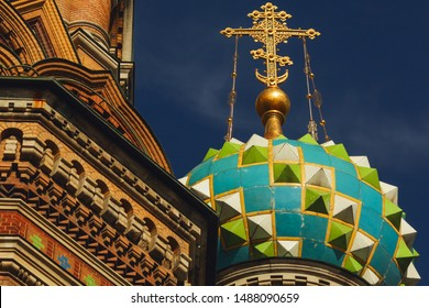 Old classical orthodox architecture concept. Decorative elements and dome of Church of the Savior on Blood in Saint Petersburg under blue sky. Outdoor shot