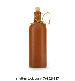Old clay bottle with cork isolated on white background