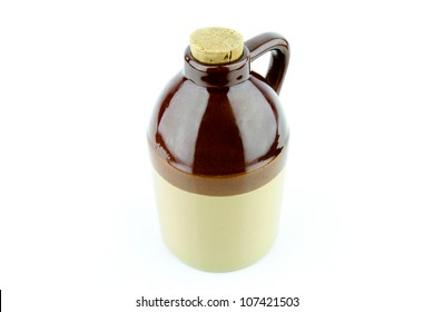 Old clay jug with a cork used to hold booze.