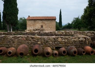 Old clay wine barrels in Georgian Monastery courtyard in Kakheti valley, Georgia