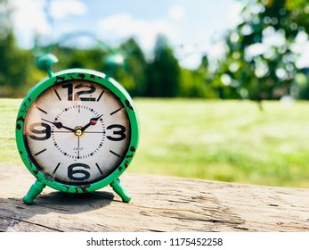 Old clock with beautiful nature background
