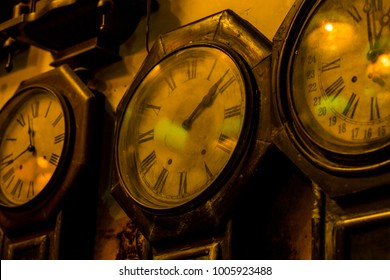 Old clock in different times.