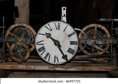 old clock with exposed clockwork