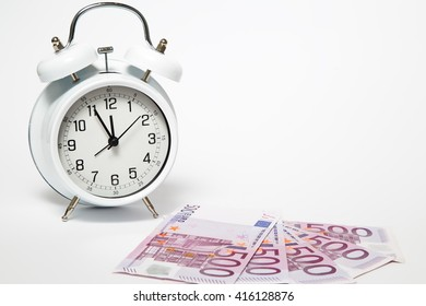 Old Clock and five hundred Euros, European bank withdraws five hundred banknotes.