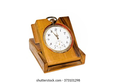 old clock in a hand on a white background