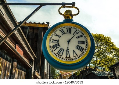 Old clock hanging on old vintage and wooden home in Turku, FInland.