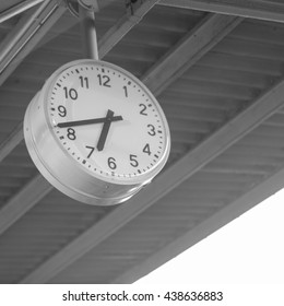 old clock mounted on the ceiling