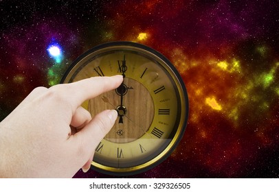 old clock on the background of the cosmos