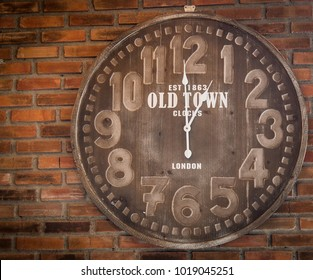 Old clock on a brick wall