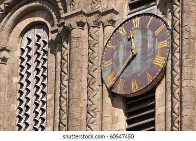 The old clock on the outside of Winchester cathedral