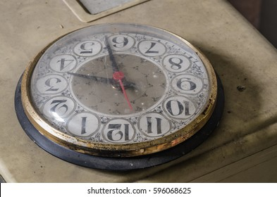 old clock on table in abandoned house
