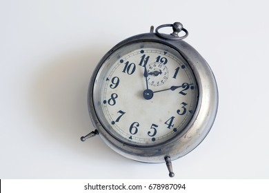 old clock on a white background. Interior shot. Nobody