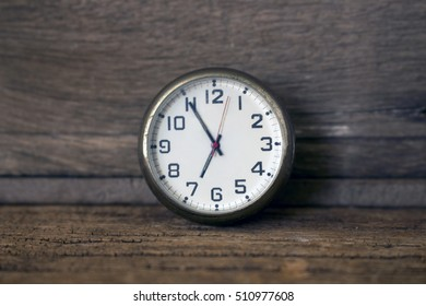 old clock on wooden background,time concept