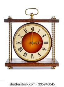 Old clock with roman numerals showing three o'clock over white background