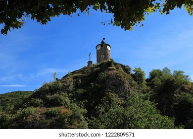 Old clock tower on the hill in Tarascon-sur-Ariege,France