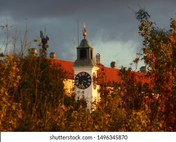 Old clock tower on the Petrovaradin fortress between the tree branches, Novi Sad, Serbia