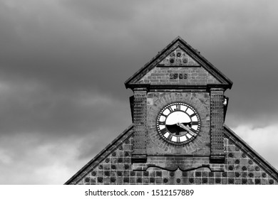 An old clock tower with a clock that has stopped working