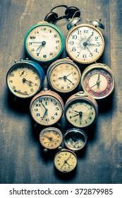 Old clocks in pile
