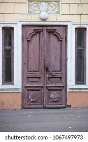 Old closed doors on house fasade