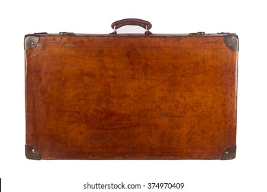 Old closed vintage suitcase viewed from the front isolated on white background