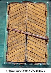 Old closed yellow window