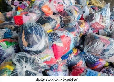 """old cloth in plastic bag for donate.The word on plastic bag in Thai is mean""""shirt"""""""