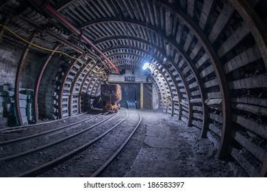 Old coal cart on tracks in mine