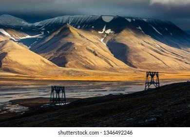 Old coal mine tranportation pillar and majestic view across Adventdalen, Longyearbyen, Svalbard, Norway