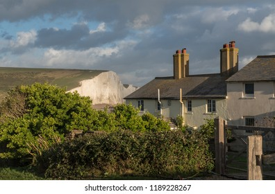 Old Coastguard cottage on the cliffs at Cuckmere Haven in East Sussex with Seven Sisters in the background