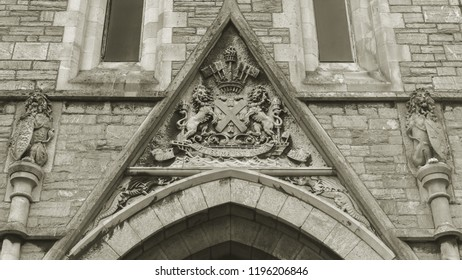Old Coat of Arms on Plymouth Guildhall, Stone Crest, Shallow Depth of Field Black and White Split Toning Horizontal Photography