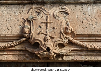 old coat of arms of the Spanish Inquisition in the town of Villanueva de Los Infantes, in Spain.
