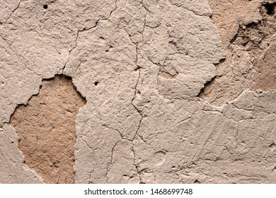 Old cob wall with cracked surface. Vintage background for design purposes