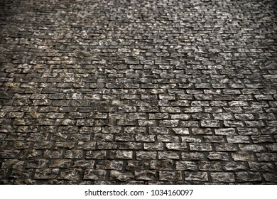 old cobble stone road surface paving background texture