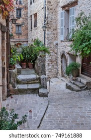 Old cobbled street in the village Vence , France.