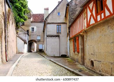 Old cobblestone lane in the village of Semur en Auxois, Burgundy, France