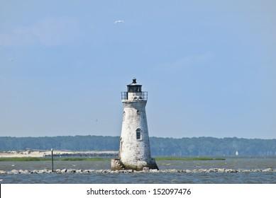 The old Cockspur Island lighthouse as seen from Tybee Island near Savannah, Georgia.