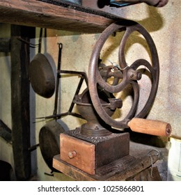 old coffee grinder  in the kitchen of a rural house in Galicia, old wooden furniture, old food storage containers, typical rural cuisine of Galicia, Galician ethnographic museum,