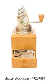 Old coffee grinder with money on white