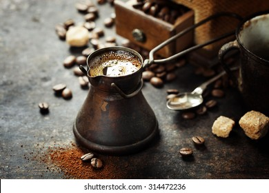 Old coffee pot and mill on dark rustic  background
