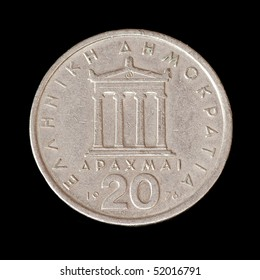 The old coin from greece on the black background