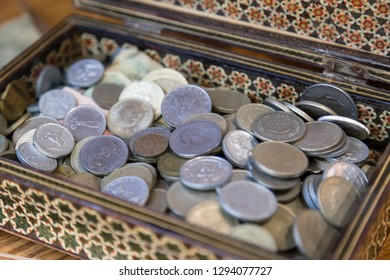the old coins in the old historical box.money investment for charities.