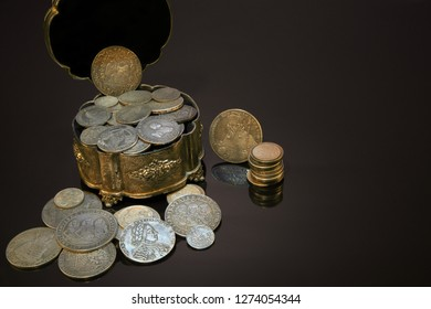 Old coins and money. Numismatics and collecting money.Russian Empire and world currency.Antiques silver,gold.The treasure chest.Finding a fortune.Treasure hood concept.