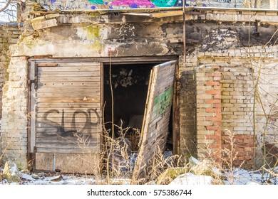 Old collapse garage with wooden door