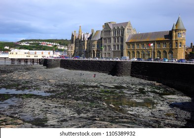 Old College and Royal Pier in welsh coastal town Aberystwyth (United Kingdom), 8-28-2015