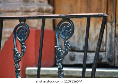 Old Colonial house handcrafted iron balcony railing in Guanajuato, Mexico.