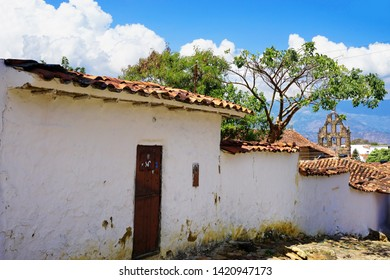 Old colonial street with background of church in Guane, Colombia