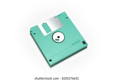 old colored computer floppy disks isolated on white