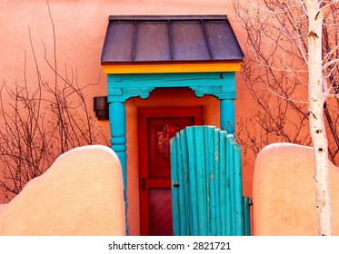 Old colored door and gated fence in Santa Fe