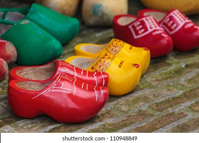 Old colorful Dutch wooden clogs for sale at an antique market
