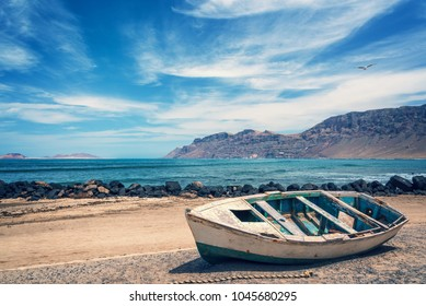 Old colorful fishing boat, atlantic ocean in the background, Lanzarote, Canary islands, Spain
